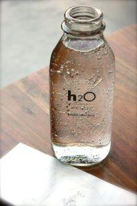 Water Bottle with h2O written on bottle.