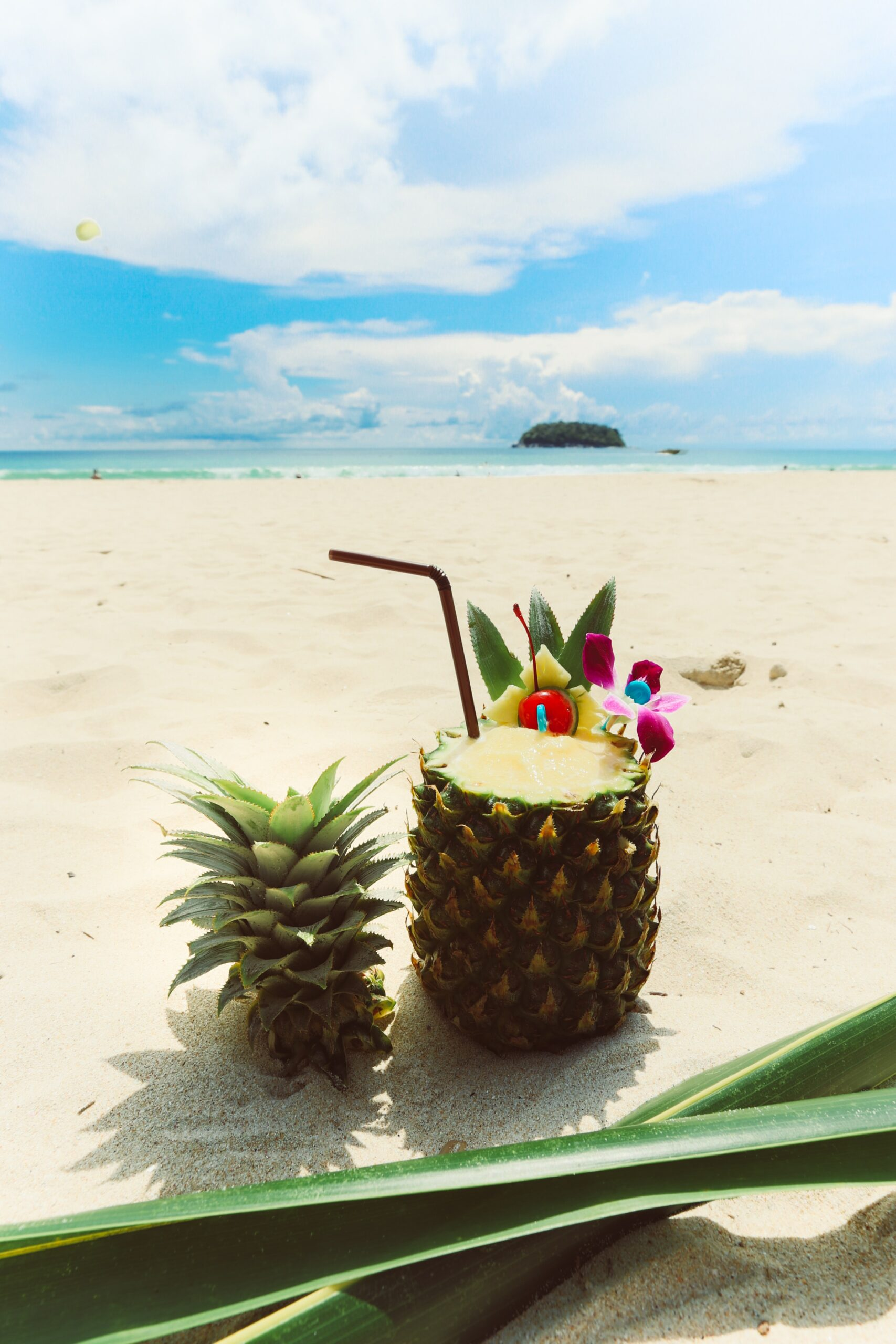 Pineapple with Top Cut Off and Straw for drinking