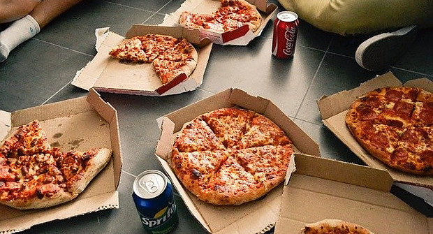 Soda cans and pizza