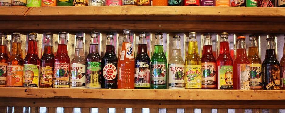 A Shelf Full of Soda Pop Bottles.