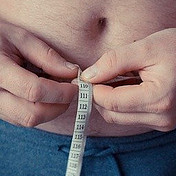Man with Measuring Tape round his Belly