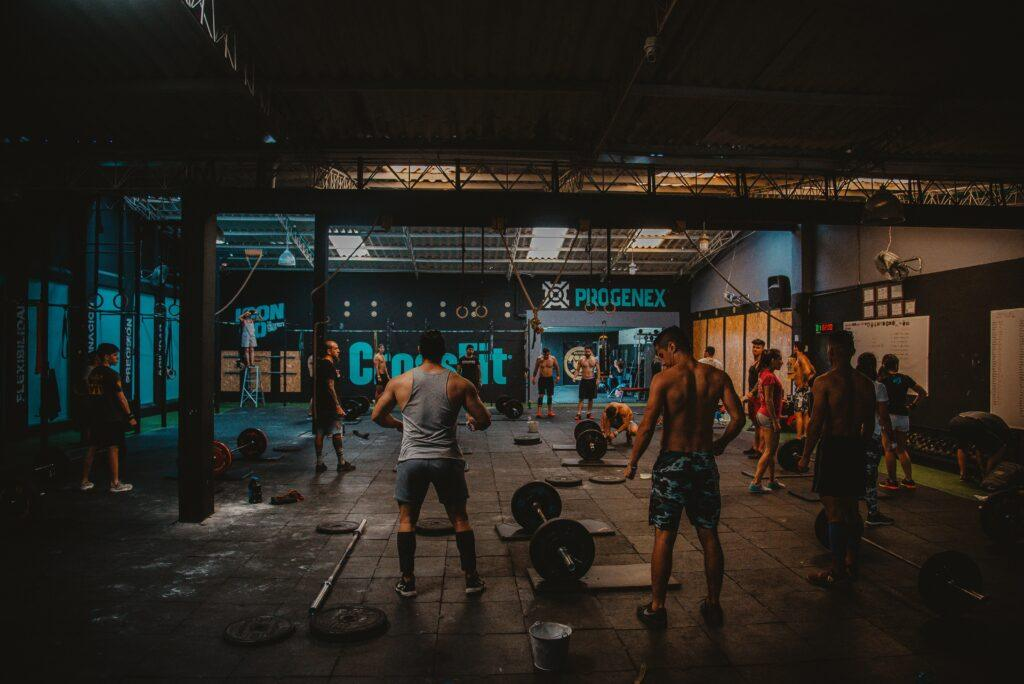 A picture looking into a Gym with Various people doing exercises