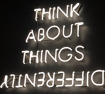 A sign saying think about things differently
