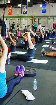 People doing aerobic exercises in a Gym