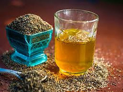 Glass of Water with Cumin Seeds