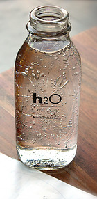 Bottle Full of water with h2o printed on the Bottle