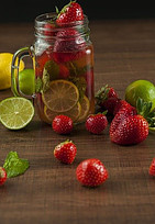 Mug Jar with water Infused with Strawberries and Lime with mint