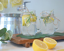 Jar mugs with water with slices of lemon