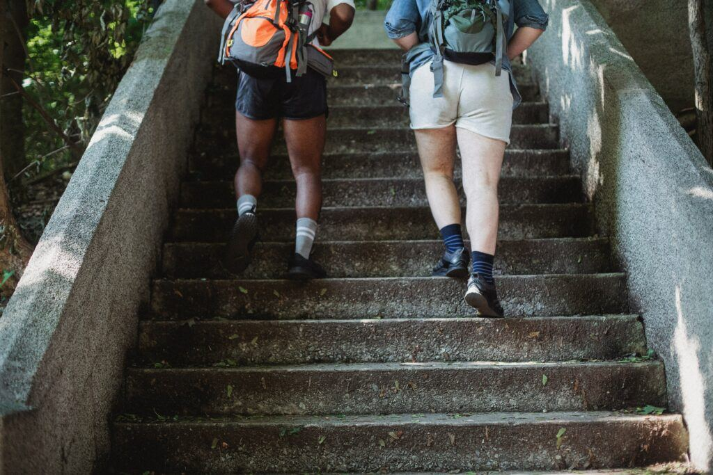 Picture of the Legs of Two men Climbing a set of stairs.