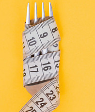 A Fork with Tape measure wrapped around the Forks.  Measure your Food