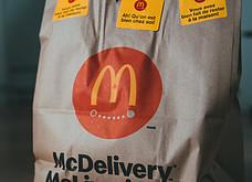 A McDonalds Paper Delivery bag of Junk Food