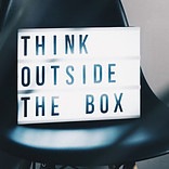 Sign Stating 'Think outside the Box'
